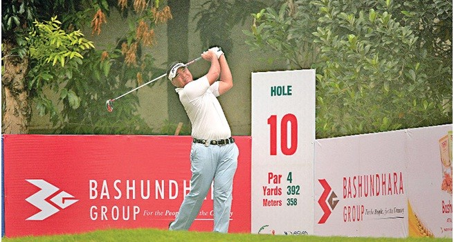 Singapore golfer Mardan Mamat tees off on the 10th hole during the first round of the Bashundhara Bangladesh Open at Kurmitola Golf Club in Dhaka on Wednesday. Mamat battled to a five-under-par 66 to share the clubhouse lead with United States golfer Casey O'Toole in the opening round.